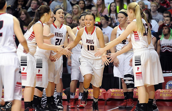 NRHEG's Paige Overgaard smiles as she is introduced before the start of the Class AA state championship game Saturday at Williams Arena. Photo by Pat Christman