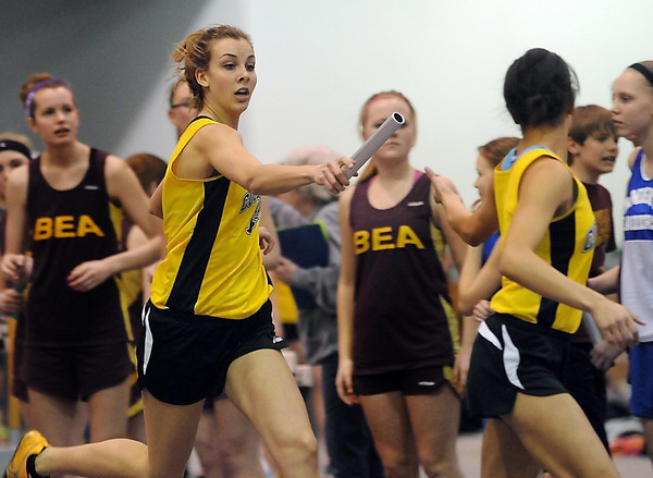Mankato East's Taylor Karge hands off the baton during the 4x200 meter relay Thursday at the Myers Field House. Pat Christman
