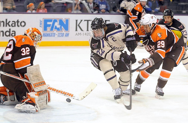 Pat Christman<br /> Minnesota State's Johnny McInnis takes a shot as Bowling Green goalie Tomas Scholl makes the save during the second period Saturday at the Verizon Wireless Center.