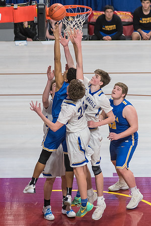 Kyreese Willingham of Waseca puts up a shot surrounded by Academy of Holy Angels defenders in the second half of Wednesday's quarterfinal game. Willingham scored 17 points along with 12 rebounds to help in Waseca's 82-62 win. Photo by Jackson Forderer
