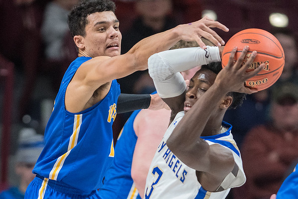 Malik Willingham of Waseca goes for a steal against the Academy of Holy Angels' Charles Johnson in Wednesday's quarterfinal game of the Class AAA Boys Basketball State Tournament. Willingham led the Bluejays to a 82-62 win with 22 points and 11 rebounds. Photo by Jackson Forderer