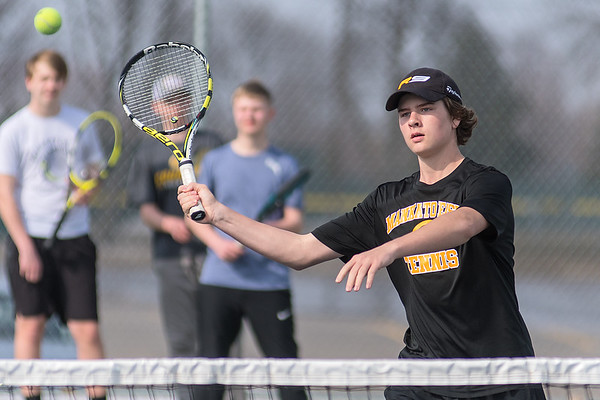 Mankato East's Mark Williams takes a forehand volley at the net during practice on Wednesday. Photo by Jackson Forderer