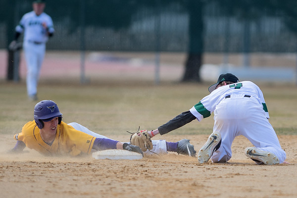 Hunter Frericks of Minnesota State (left) makes sure not to slide past second base and get tagged by Bemdji State's Blake Huntley in the second game of a double header played on Saturday. Photo by Jackson Forderer