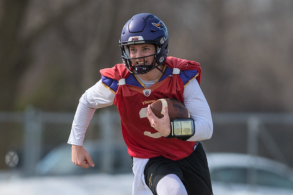 Minnesota State quarterback Ryan Schlichte runs out of the pocket during practice on Friday. It was MSU's first practice this spring. Photo by Jackson Forderer