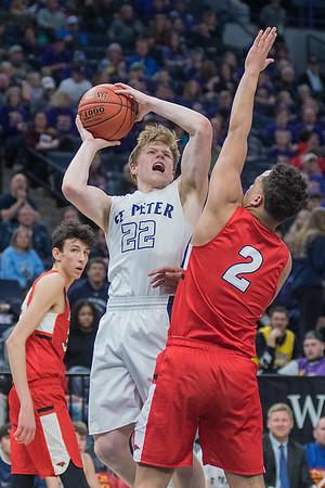 St. Peter's Brock Hanson puts up a shot against Minnehaha Academy's Kaden Johnson during Wednesday's quarterfinal game played at Target Center. Hanson finished with 10 points in the game. Photo by Jackson Forderer