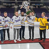 Minnesota State men's hockey captains, from left, Marc Michaelis, Nicholas Rivera and Max Coatta hoist the McNaughton Cup into the air during a celebration for the team and fans on Tuesday. Photo by Jackson Forderer
