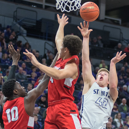 St. Peter's Seth Lokensgard puts up a shot over Minnehaha Academy's Prince Aligbe (10) and Donovan Smith. Photo by Jackson Forderer