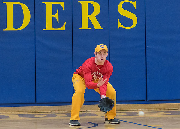 Ben Ellingworth of Mankato Loyola practices fielding a ball during practice at Fitzgerald Gymnasium on Thursday. Ellingworth will pitch and play shortstop for the Crusaders this upcoming season. Photo by Jackson Forderer