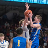 Waseca's Ryan Dufault against Academy of Holy Angels' Matt Banovetz in the second half of Wednesday's quarterfinal game. Photo by Jackson Forderer