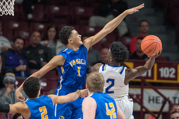Kyreese Willingham (1) of Waseca defends against a shot put up by Academy of Holy Angels' Emmett Johnson in the first half of Wednesday's game. Willingham had 17 points and 12 rebounds in the Bluejays win. Photo by Jackson Forderer