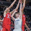 Minnehaha Academy's Chet Holmgren (left) rebounds the ball over St. Peter's Eli Lubiani during a quarterfinal game played at Target Center on Wednesday. Photo by Jackson Forderer