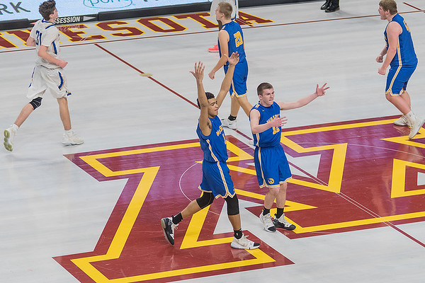 Waseca's Kyreese Willingham and Ryan Dufault get the crowd pumped after Academy of Holy Angels called a timeout during a Bluejays run. Photo by Jackson Forderer
