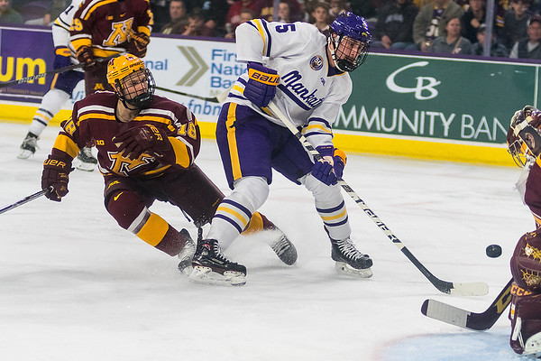 Minnesota State's Jake Jaremko watches his shot rebound off of University of Minnesota goalie Eric Schierhorn in the second period. Jaremko would later score the game-winning goal on a shot that rebounded off of Schierhorn and caromed off of a Gopher's skate into the goal. Photo by Jackson Forderer