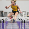 Jenna Pasker runs in the 60 meter high hurdles during Thursday's track meet held at Myers Field House. Photo by Jackson Forderer