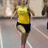 Emma Baynes runs in the 60-meter dash at Mankato East's first track meet of the season held on Thursday at Bud Myers Field House. Photo by Jackson Forderer