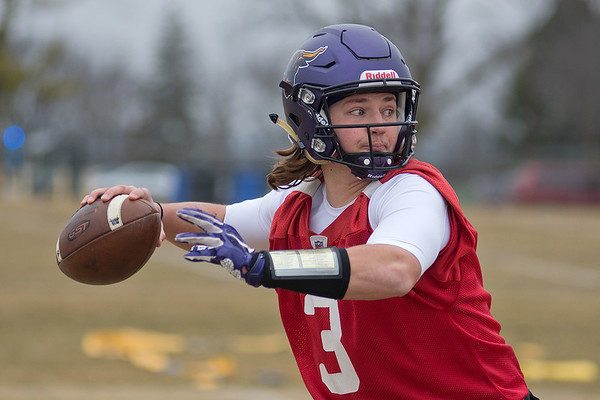 Ryan Schlichte of Minnesota State eyes a receiver during Saturday's practice. It was MSU's first practice of the 2017 season and Schlichte opened as the No. 1 quarterback on the Mavericks roster. Photo by Jackson Forderer