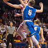 New Richland-Hartland-Ellendale-Geneva's Benji Lundberg goes in for a layup against Jackson Jangula (5) of St. Cloud Cathedral. Lundberg hit a three-pointer in the final seconds of regulation to send the game into overtime. The Panthers lost in overtime 59-70. Photo by Jackson Forderer