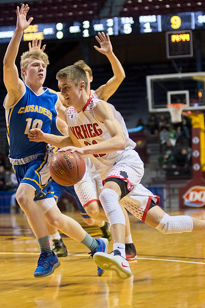 Oakley Baker of New Richland-Hartland-Ellendale-Geneva tries to get past St. Cloud Cathedral's William Kranz (10). Baker scored 16 points for the Panthers. Photo by Jackson Forderer