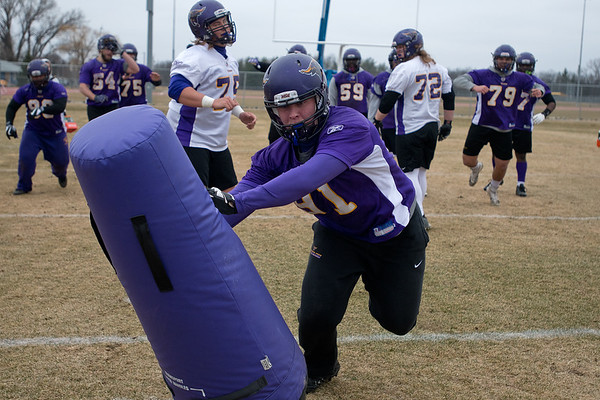 Josh Kawlewski of Minnesota State reaches a tackle dummy that was set in place of the quarterback in a drill that pitted the offensive line versus the defensive line. Minnesota State held its first football practice of the 2017 season on Saturday. Photo by Jackson Forderer