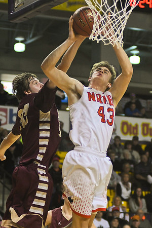 New Richland-Heartland-Ellendale-Geneva's Tyler Raimann (43) goes up for a shot against Eric Tiedman of Jordan. Raimann led the Panthers in scoring with 17 to lift NRHEG to a state tournament berth. Photo by Jackson Forderer