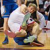 Tyler Raimann fights for a loose ball against a St. Cloud Cathedral player in the second half. Photo by Jackson Forderer