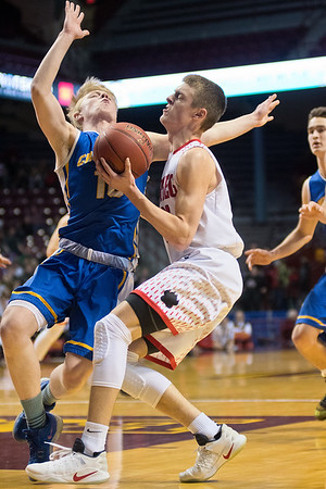 Oakley Baker of New Richland-Hartland-Ellendale-Geneva crashes into St. Cloud Cathedral's William Kranz as he drove to the basket in the first half. Baker scored 16 points for the Panthers. Photo by Jackson Forderer