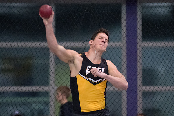 Dom Nussmeier makes his second throw in the shot put event during Mankato East's first track meet of the year held at Bud Myers Field House on Thursday. Photo by Jackson Forderer
