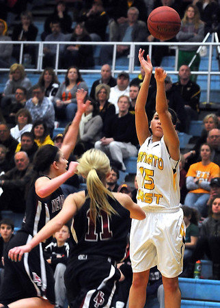 Mankato East'sAbby Connell shoots a three point shot ahead of a pair of New Prague defenders during the first half of their Section 2AAA championship game Thursday at Gustavus Adolphus College.