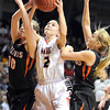 New Richland-Hartland-Ellendale-Geneva's Marnie Wagner reaches for a rebound between Pelican Rapids' Lincoln Haiby (10) and Mackenzie Korf during the first half of their State Class AA quarterfinal game Wednesday at Williams Arena.