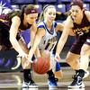 Mankato Loyola's Aunikah Bastian is surrounded by Lester Prairie/Holy Trinity's Krista Lange (left) and Rachel Heuer as she races for a loose ball during the first half of their Section 2A championship game Friday at Bresnan Arena.