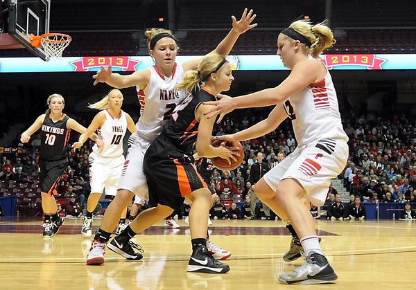 New Richland-Hartland-Ellendale-Geneva's Marnie Wagner (2) and Jade Schultz (12) surround Pelican Rapids' Sommer Haugrud during their State Class AA quarterfinal game Wednesday at Williams Arena.