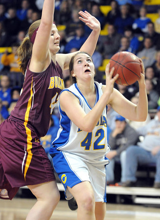 Mankato Loyola's Annie Nawrocki looks to shoot around the outstretched arm of Lester Prairie/Holy Trinity's Shelby Fasching during the first half of their Section 2A championship game Friday at Bresnan Arena.