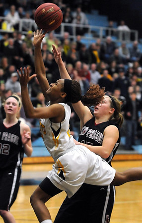 Mankato East's Minnie Frederick misses a last second shot to tie the game during their Section 2AAA championship game against New Prague Thursday at Gustavus Adolphus College.