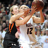 Pelican Rapids' Kendra Weinrich collides with New Richland-Hartland-Ellendale-Geneva's Jade Schultz  during their State Class AA quarterfinal game Wednesday at Williams Arena.