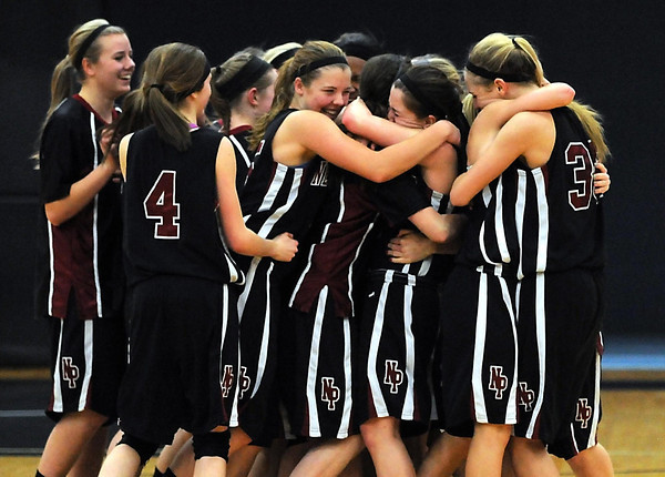 New Prague players celebrate after defeating Mankato East 54-52 in the Section 2AAA championship game Thursday at Gustavus Adolphus College.