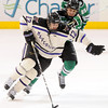 Minnesota State's Jean-Paul Lafontaine (12) slips by North Dakota's Mark MacMillan during the first period Saturday.