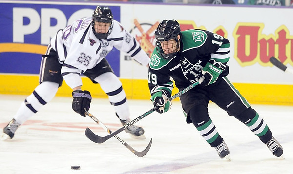 Minnesota State's Dylan Margonari pursues North Dakota's Rocco Grimaldi during the first period Friday at the Verizon Wireless Center.