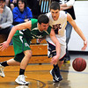 Maple River's Tanner Thiesse (left) swats the ball away from United South Central's Walker Linde during their Section 2AA, South Subsection semifinal game Thursday at the East gym.