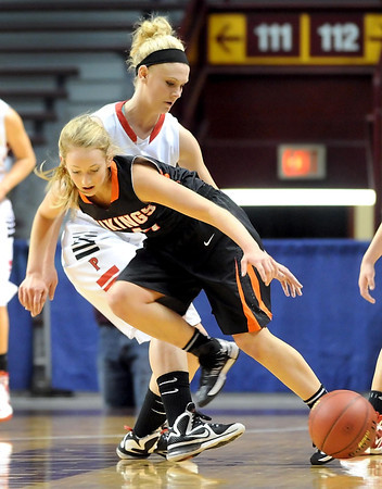 New Richland-Hartland-Ellendale-Geneva's Carlie Wagner tips the ball away from Pelican Rapids' Mackenzie Korf during the first half of their State Class AA quarterfinal game Wednesday at Williams Arena.