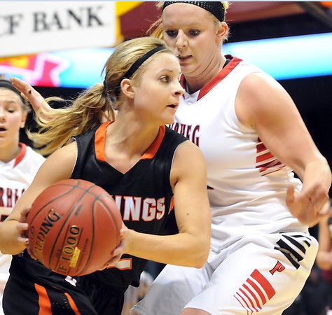 New Richland-Hartland-Ellendale-Geneva's Jade Schultz defends Pelican Rapids' Sommer Haugrud during their State Class AA quarterfinal game Wednesday at Williams Arena.