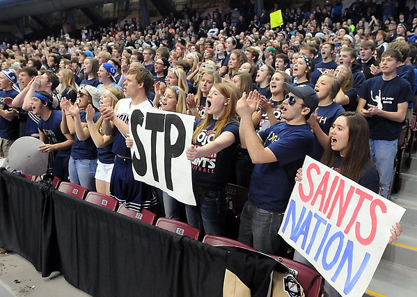 Pat Christman<br /> St. Peter boys basketball fans cheer before the beginning of their State Class AA quarterfinal game against Fairmont Wednesday at the University of Minnesota's Williams Arena.