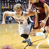 Pat Christman<br /> St. Peter's Tom Steidler lunges for  a ball ahead of Fairmont's Josh Eversman during the second half of their State Class AA quarterfinal game Wednesday at the University of Minnesota's Williams Arena.