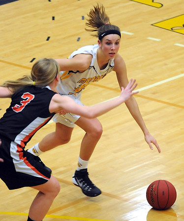 Pat Christman<br /> Mankato East's Taylor Karge looks for a way around Marshall's Sarah Buysse during the first half of their Section 2AAA tournament game Saturday at Gustavus Adolphus College.