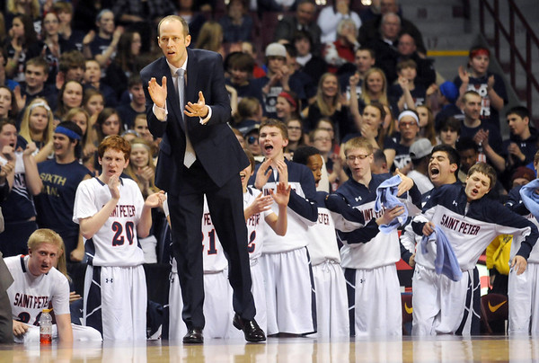 Pat Christman<br /> St. Peter coach Sean Keating and the bench applaud during the first half of their State Class AA quarterfinal game Wednesday at the University of Minnesota's Williams Arena.