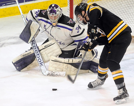 Pat Christman<br /> Minnesota State goalie Cole Huggins makes a save on a shot by Michigan Tech's Reid Sturos during the first period Saturday.