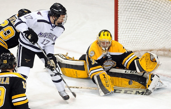 Pat Christman<br /> Minnesota State's Michael Huntebrinker watches his shot deflect past Michigan Tech goalie Pheonix Copley during the first period Friday at the Verizon Wireless Center.