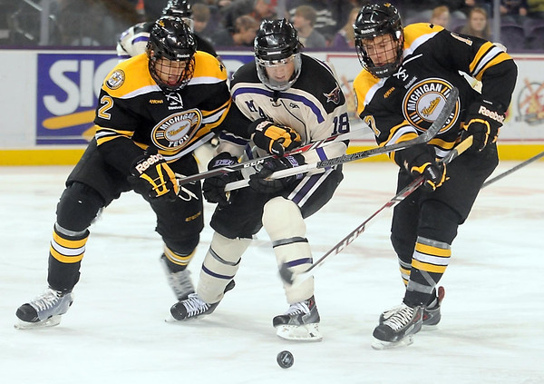 Pat Christman<br /> Minnesota State's Matt Leitner is sandwiched between Michigan Tech's Cliff Watson (2) and Riley Sweeney (17) during the second period Saturday at the Verizon Wireless Center.