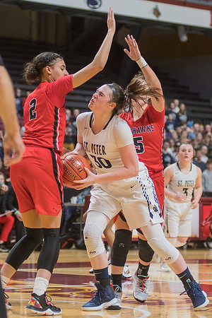 After spinning away from Minnehaha Academy's Mia Curtis, St. Peter's Morgan Kelly runs into Nevaeh Galloway in the first half of Wednesday's game. Photo by Jackson Forderer