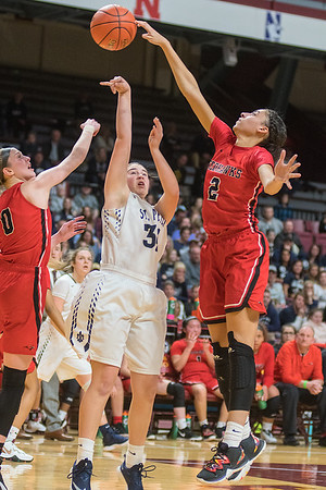 Minnehaha Academy's Nevaeh Galloway rejects St. Peter's Grace Remmert during Wednesday's Class AA quarterfinal game. Photo by Jackson Forderer