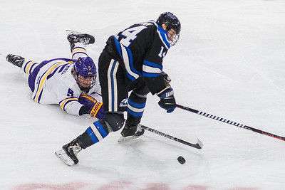 Jake Jaremko of Minnesota State continues to go after the puck while on the ice against University of Alabama-Huntsviile's Madison Dunn in the second period of Saturday's WCHA tournament playoff game. The Mavericks won the game 4-1 to advance in the conference tournament. Photo by Jackson Forderer
